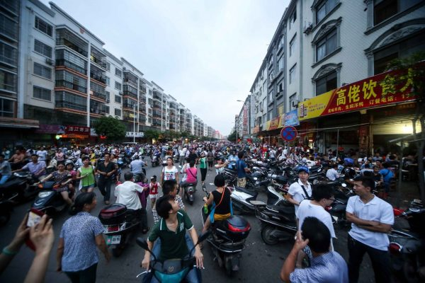 The overly crowded streets outside of dog meat restaurants.