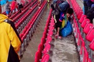 Japanese fans clean up their section after World Cup match