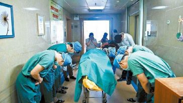Chinese doctors bow to the body of an 11-year-old boy who donated his organs to save others after dying from brain cancer.