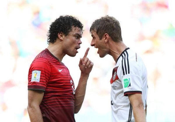 Pepe (left) and Muller (right), arguing during the 2014 Brazil World Cup Group G match between Germany and Portugal.