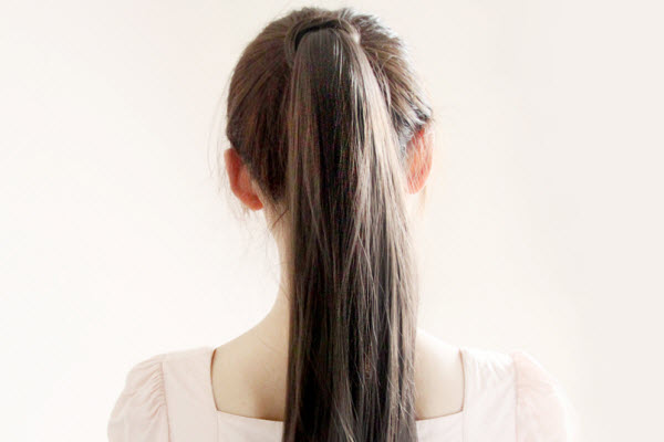 An Asian girl with a ponytail.