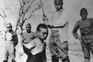 A Chinese man about to be beheaded by Imperial Japanese soldiers.