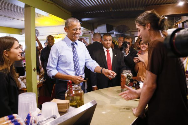 President Barack Obama cuts in line at Franklin Barbecue in Austin, Texas, pays for meal of another customer using credit card.