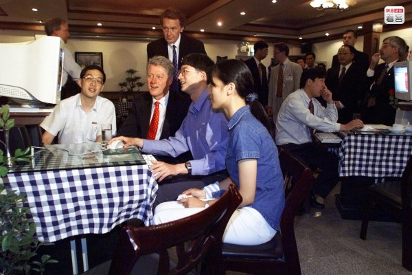US President Bill Clinton at an internet bar in Shanghai, China.