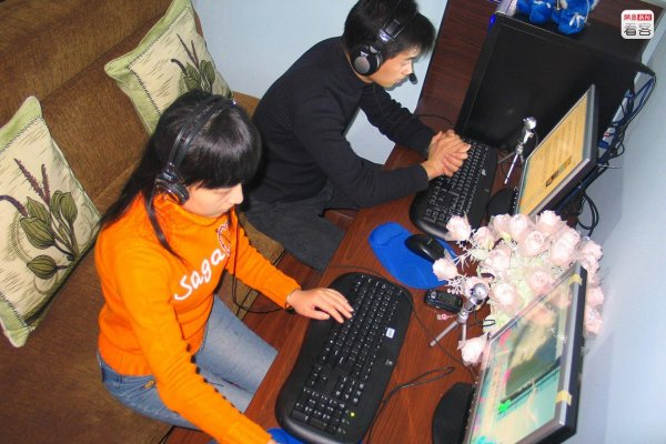 "A couple in a ""couple's booth"" at an internet bar in China."