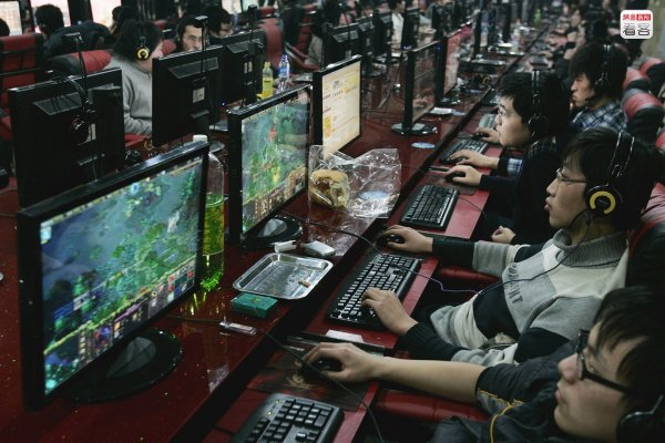 Chinese youth playing online games at an internet bar.