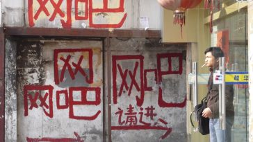 """Wangba"" grafitti points to the entrance to an internet bar in China."