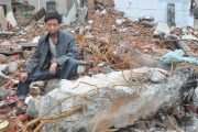 Zhong Hongwei stands upon the ruins of his home in Henan, that was forcibly demolished after he and his wife were abducted in the middle of the night.
