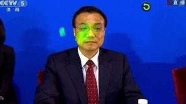 Chinese Premier Li Keqiang at the 2014 Nanjing Youth Olympics, with a laser pointer directed at his face by an athlete from the Korean delegation.