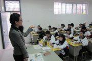 A female teacher teaching her high school class in China.