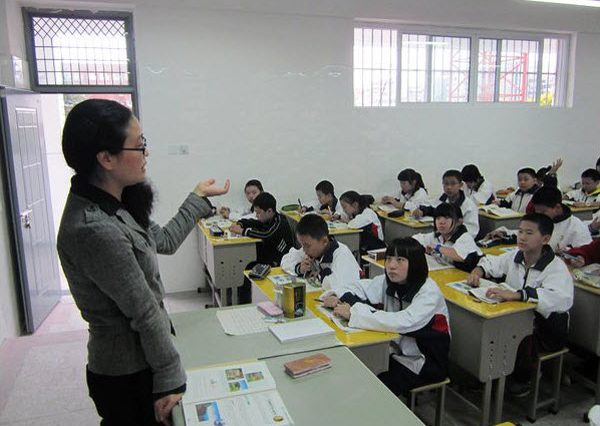 A female teacher teaching her high school class in China.
