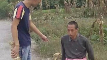 A Chinese teenager photographed apparently bullying and beating a mentally handicapped man.