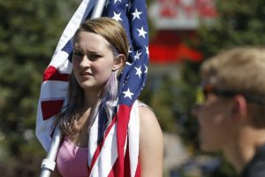 American students in Denver, Colorado take to the streets to protest changes to their history curriculum that would emphasize patriotism and discourage civil disorder.