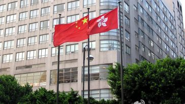 Hong Kong SAR flag with PRC national flag.