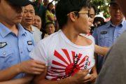 man-with-imperial-japanese-navy-rising-sun-flag-t-shirt-stripped-taishan-china-03