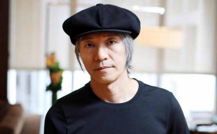 Stephen Chow, with grey hair.