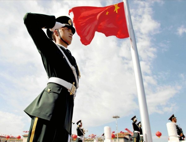 A soldier salutes at the morning flag-raising ceremony in Beijing on 2014 October 1, the 65th anniversary of the founding of the People's Republic of China.