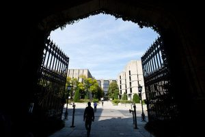 A view of an American university campus through an arch.