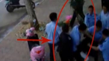 City management personnel in Jiangxi, China are caught on film apparently beating up the husband and wife couple that owns a flower shop.