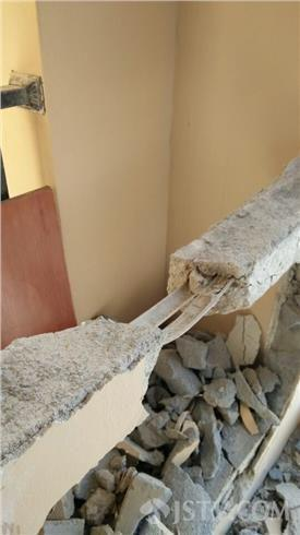 A wall torn down in a newly constructed apartment building in Jiangsu, China, where bamboo was found in the place of steel rebar.