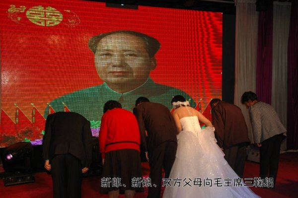 "A Chinese couple in Shanxi province hold a ""Mao Style"" wedding."