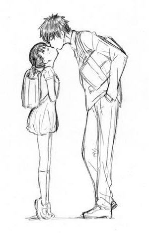 A short girl kissing a tall boy.