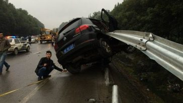 A Volkswagen Tiguan SUV impaled on a highway railing after multiple hit and runs that killed a family of three.
