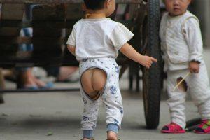 Chinese children wearing open-crotch pants aka split pants.