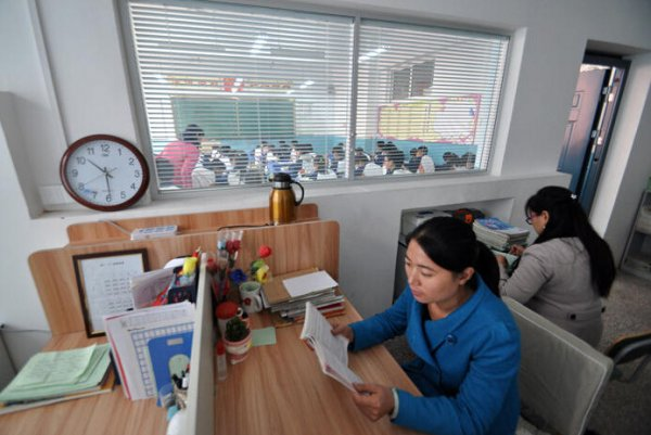 teachers-office-next-to-classroom-monitor-students-in-china-01