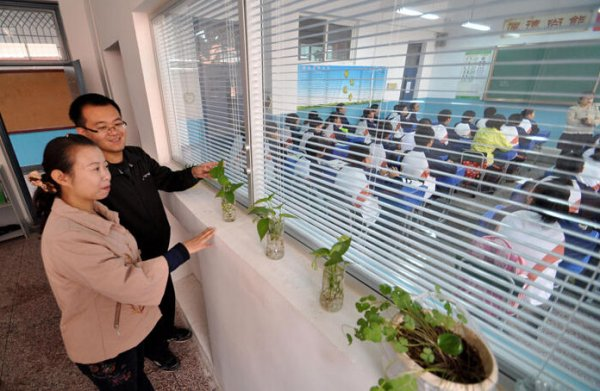 teachers-office-next-to-classroom-monitor-students-in-china-03