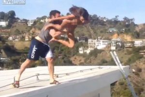 Dan Bilzerian throws a female model off a roof and into a pool