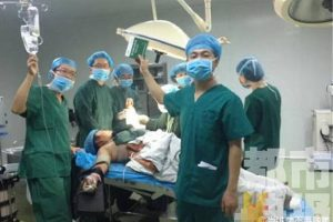 Chinese doctors take selfies and group photos during surgery in an operating room while the patient is still on the table next to them.