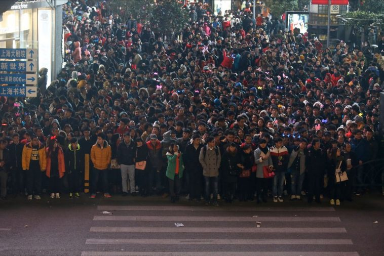A Chinese crowd waiting to cross the street during 2014 Shanghai New Year's Eve festivities at the Bund.