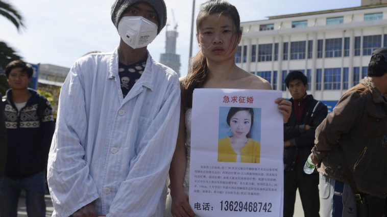 A Chinese girl offers to marry any man willing to save her younger brother by paying for his expensive medical expenses.
