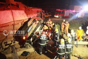 A tragic traffic accident in Yiwu, China where a Lexus was crushed by a cargo truck.
