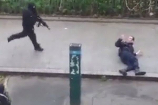 A gunman executes a wounded Parisian police officer in the 2015 Charlie Hebdo terrorist attack.
