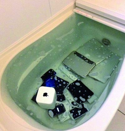 Japanese Woman Puts Cheating Boyfriend's Electronics In Bathtub