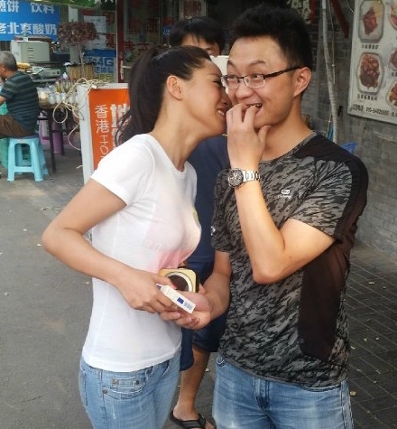 Beijing Woman Trades Kisses for Cigarettes to Support New Regulations
