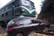 Freight Train Collides With Car Stalled on Railway Line