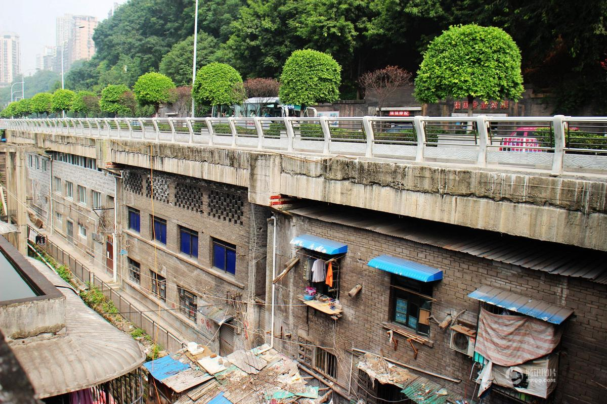 Buildings In Gap Under Road In Chongqing