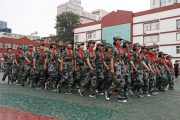 Students' Military Parade Continues Despite Heavy Rain