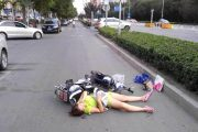 Woman Falls Down On Scooter, Lies In Middle Of Street