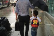 Dad A Big Hit For Getting Soaked Holding Umbrella For Son