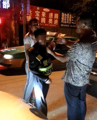 Drunken Passenger Slaps Traffic Cop Multiple Times